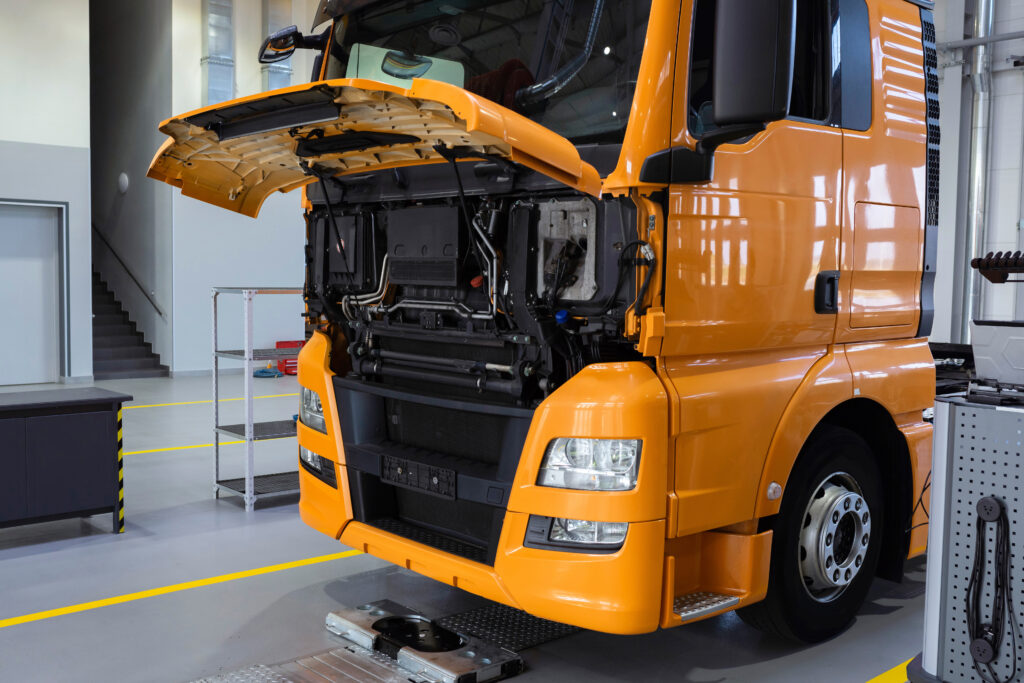 Service maintenance of trucks. Truck under repair at a service station. Car repair and inspection, car service, diagnostics